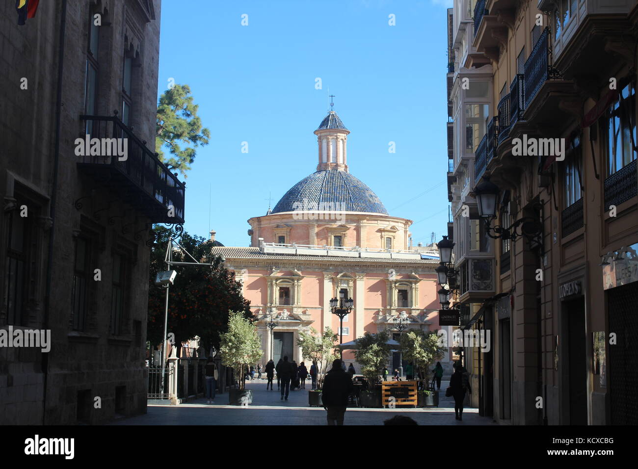 A view through the streets of valencia, toward the plaza de la virgen and the Basílica de la Mare de Déu - Stock Image