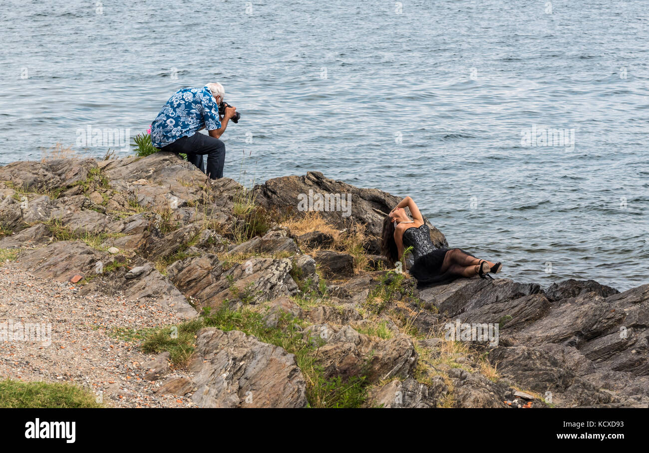 Photographer and model during a photo shoot on Isola dei Pescatori on Lake Maggiore, Italy Stock Photo