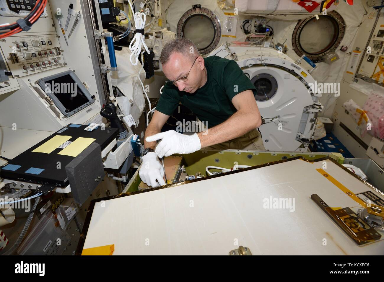 NASA Expedition 52 crew member American astronaut Randy Bresnik repairs the Main Bus Switching Unit onboard the Stock Photo