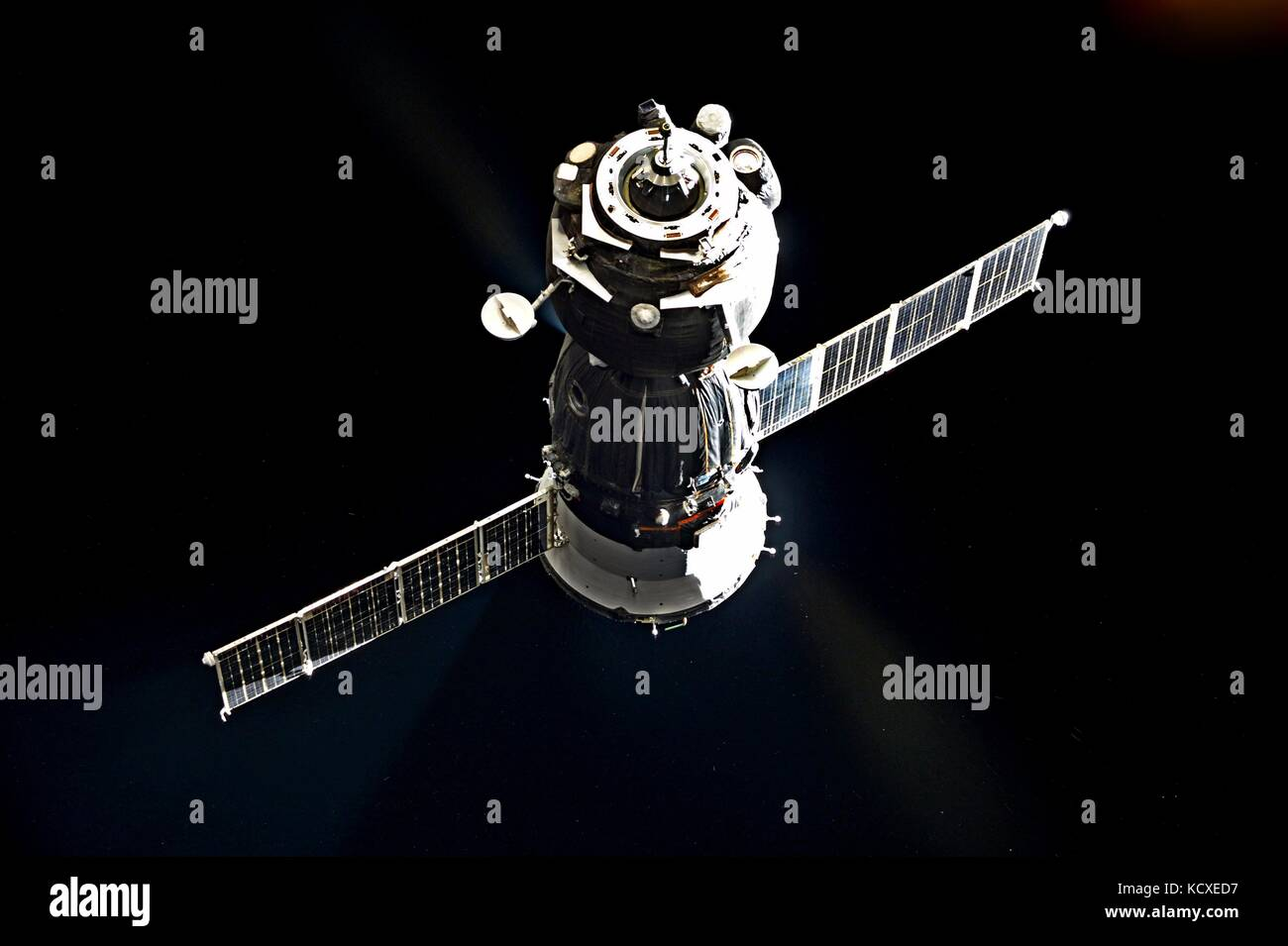 The Russian Soyuz spacecraft approaches the International Space Station for docking August 5, 2015 in Earth Orbit. Stock Photo