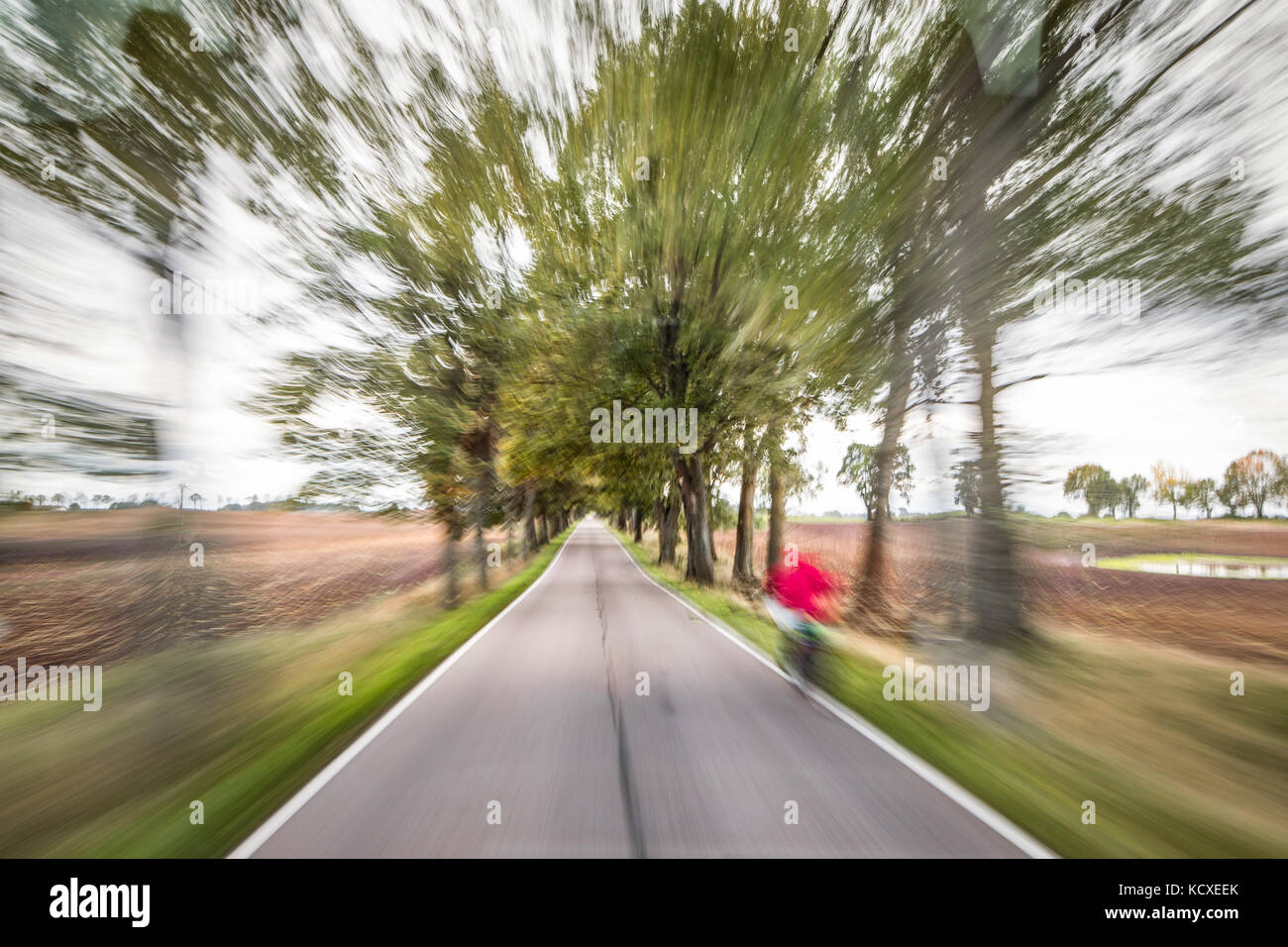 City evening lights, highway zoomed perspective blurred by high speed of the car. - Stock Image