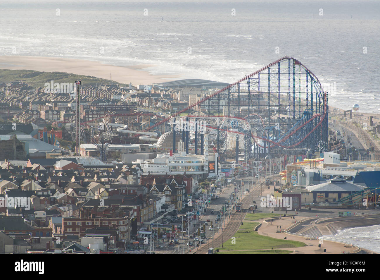 Image of Blackpool Pleasure beach on a sunny summers afternoon. Credit Lee Ramsden / Alamy - Stock Image