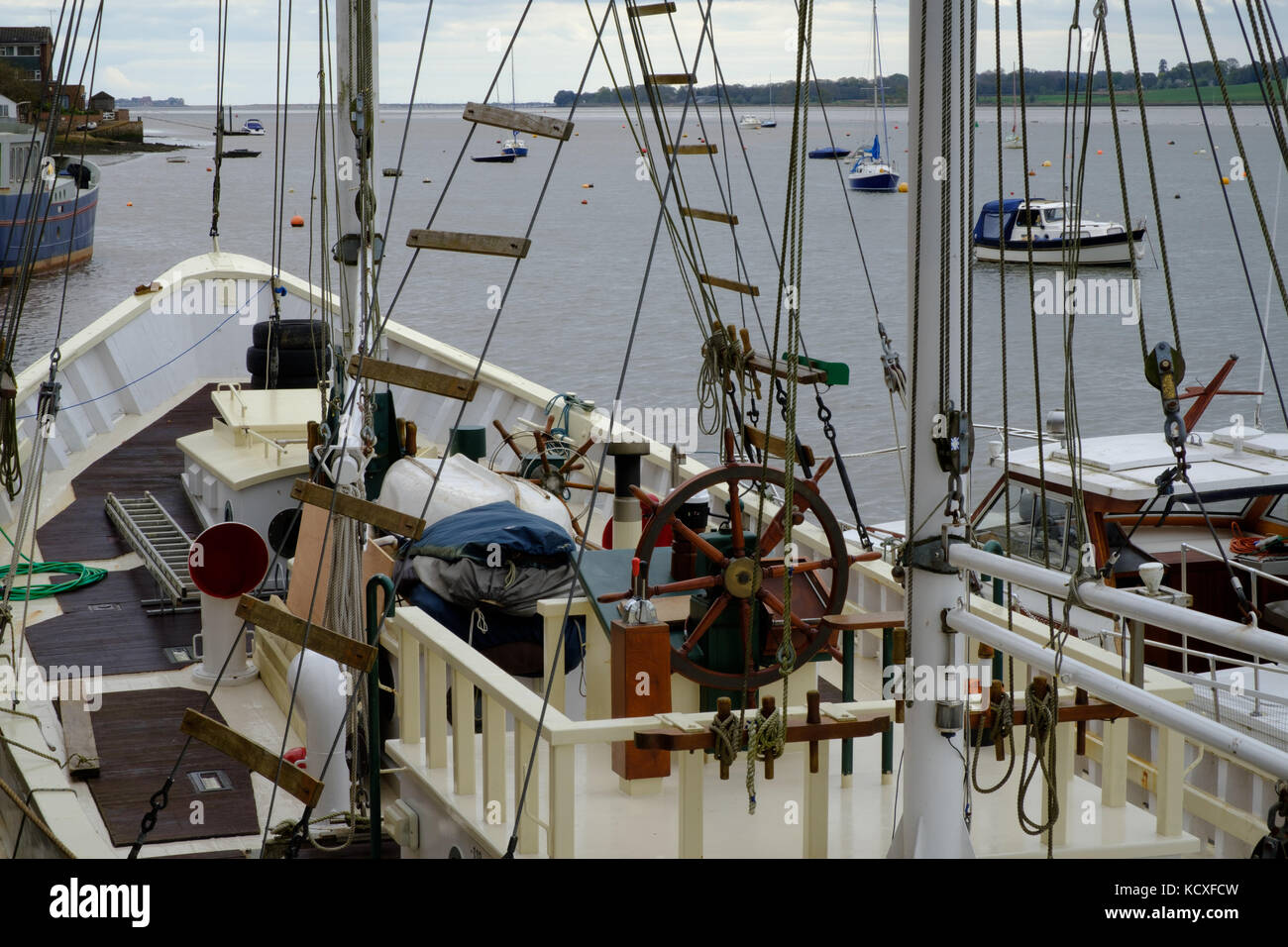 Traditional wooden boat moored at Topsham on River Exe, UK - Stock Image