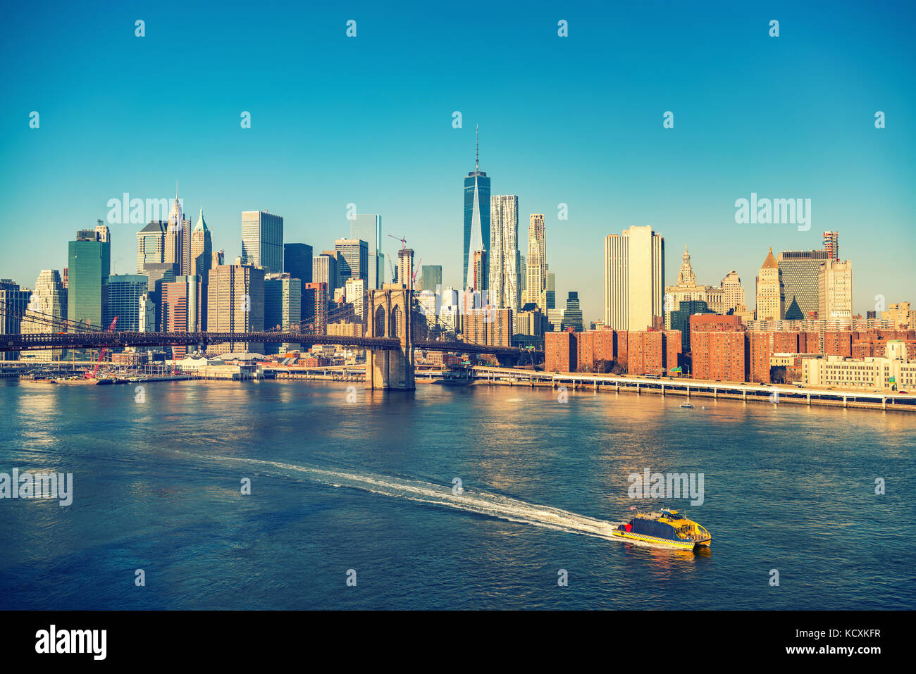 Brooklyn bridge and Manhattan at sunny day - Stock Image