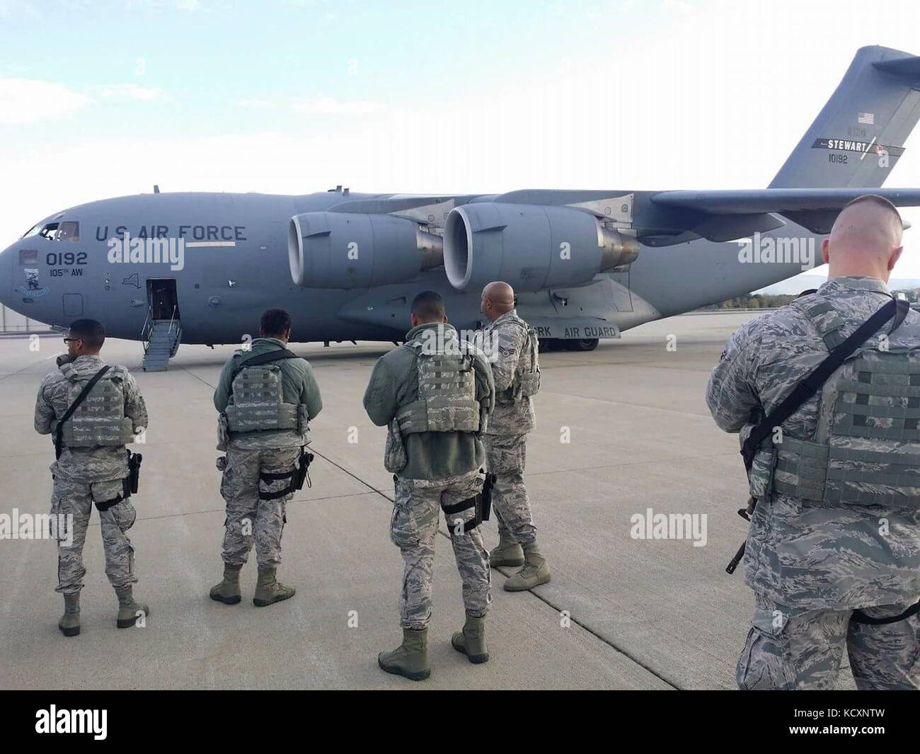 New York Air National Guard Airmen assigned to the 105th Airlift Wing's Base Defense Squadron wait to board one Stock Photo