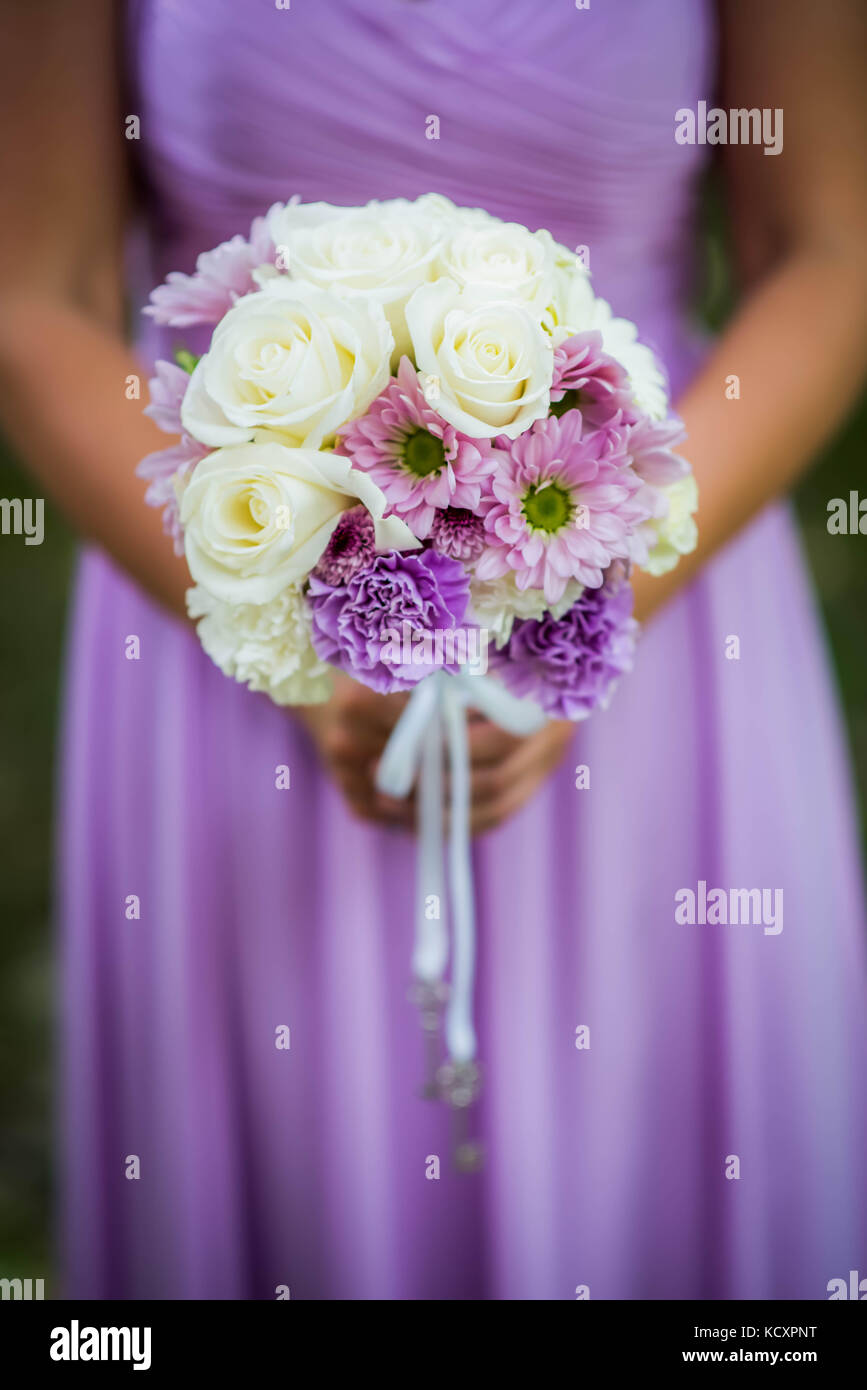 Bridesmaid Holding Bouquet With White Purple And Lavender Flowers Stock Photo Alamy