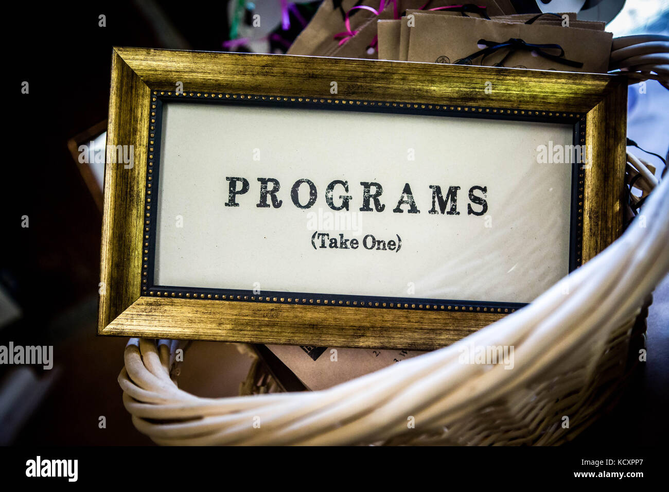Rustic, retro, chic, or old sign used at a wedding or theater performance to hand out programs. - Stock Image
