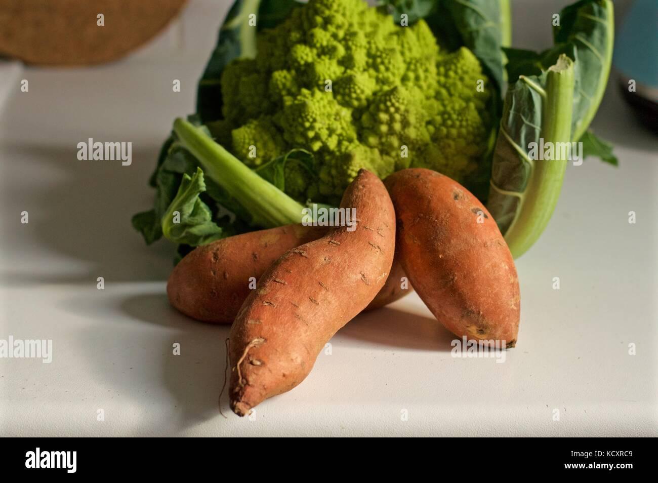 Romanesco Broccoli and sweet potatos - Stock Image
