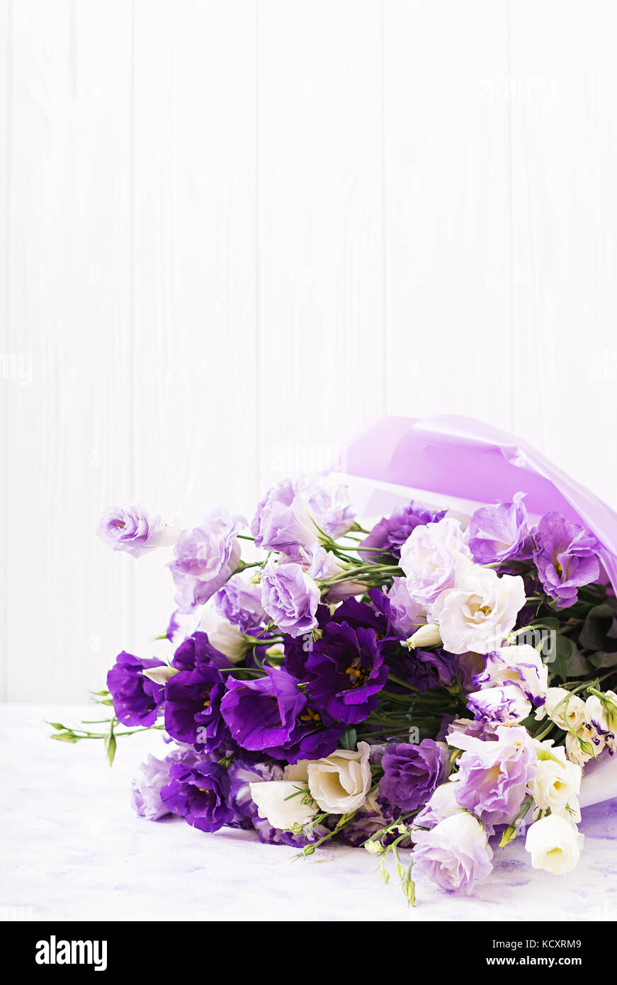 Beautiful flowers bouquet mix of white, purple and violet eustoma. Stock Photo