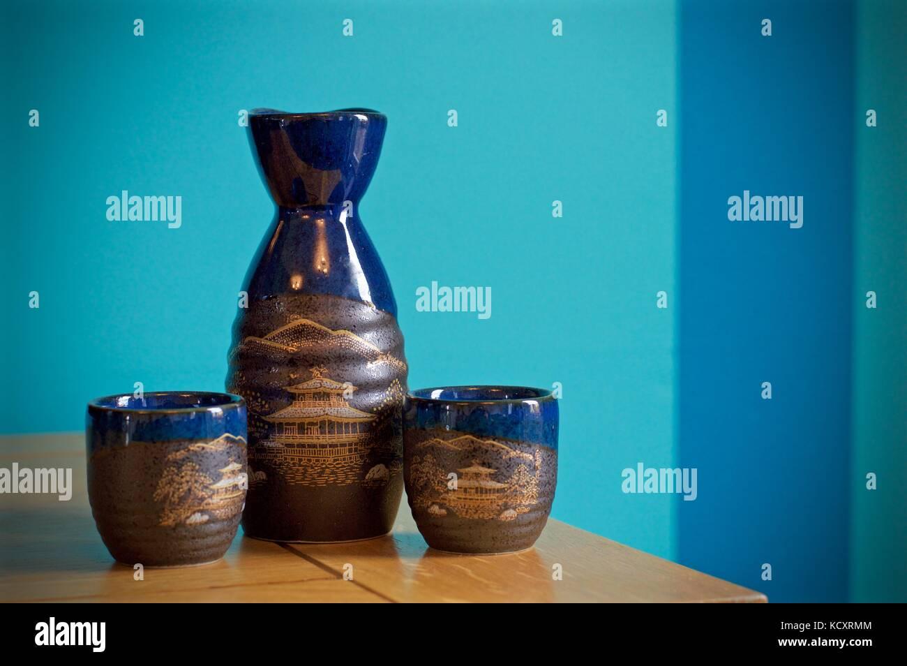 Japanese sake set on sideboard - Stock Image
