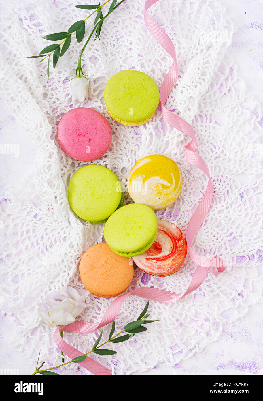 Colorful macaroons  on a ligth  background. Flat lay. Top view - Stock Image