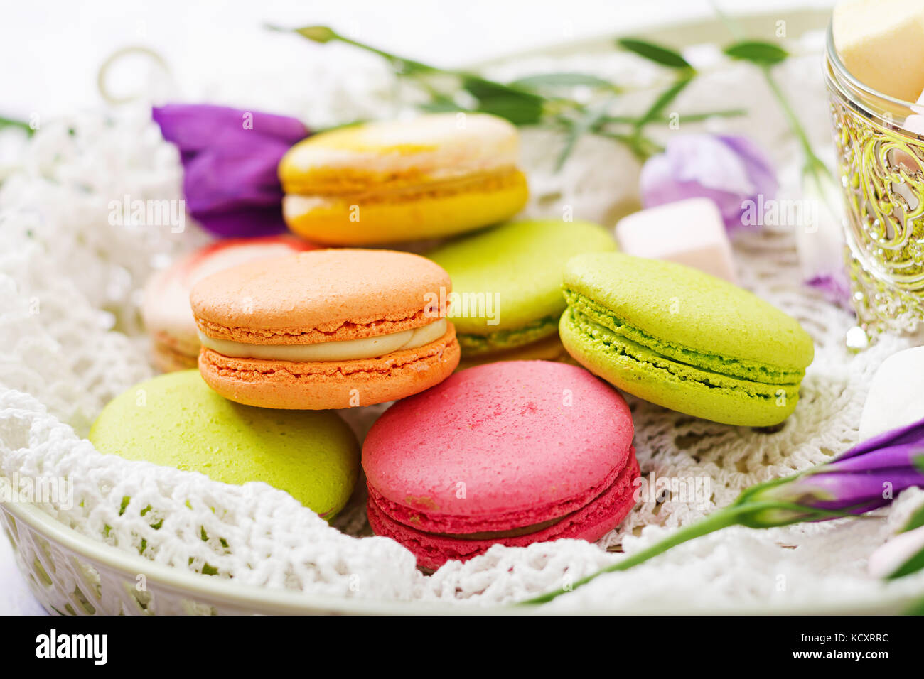 Colorful macaroons and marshmallows on a ligth  background. - Stock Image