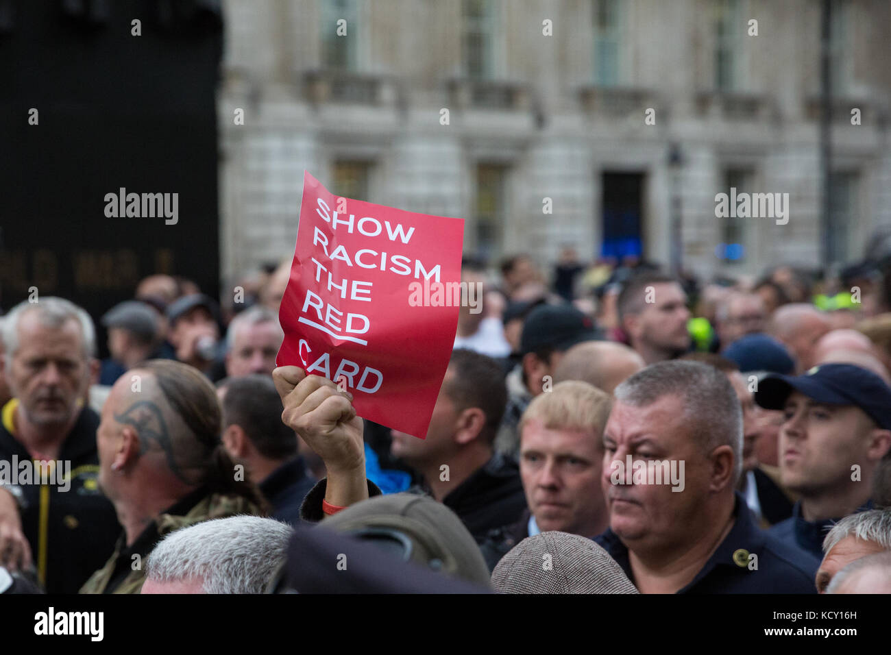 London, UK. 7th October, 2017. Supporters of the Football Lads Alliance (FLA) move past anti-racist campaigners - Stock Image