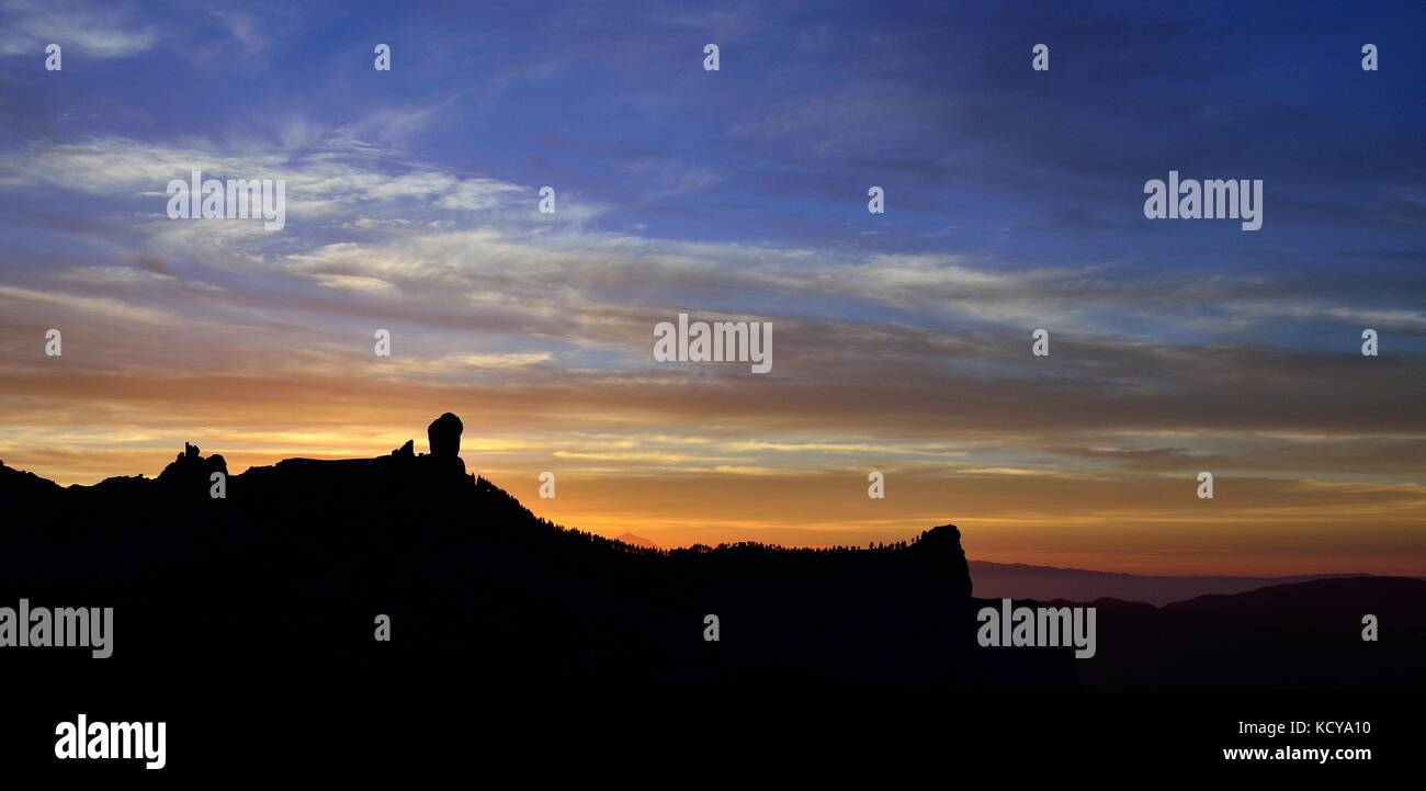 Natural park of Roque Nublo with sky of intense colors at nightfall, Canary islands - Stock Image