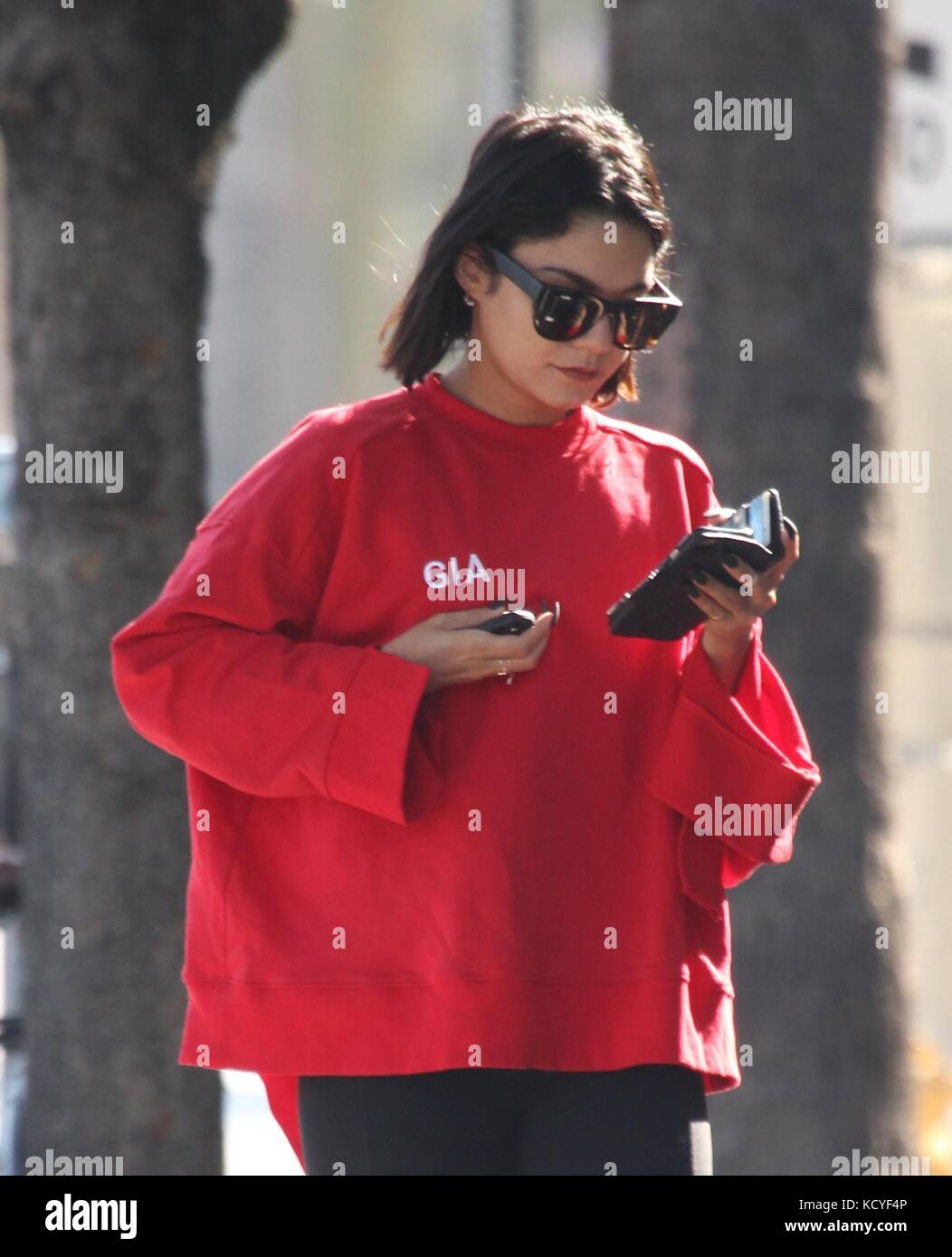 c95d4aa7c25 Vanessa Hudgens busy on her cell phone as she arrives for her pilates class  in Studio