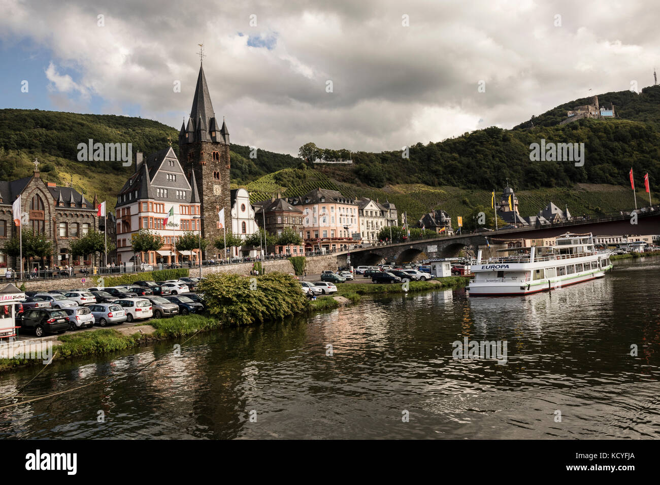 The town of Bernkastel-Kues, in the Mosel Valley, Germany. Photographed from the river boat. Showing the river cruiser - Stock Image