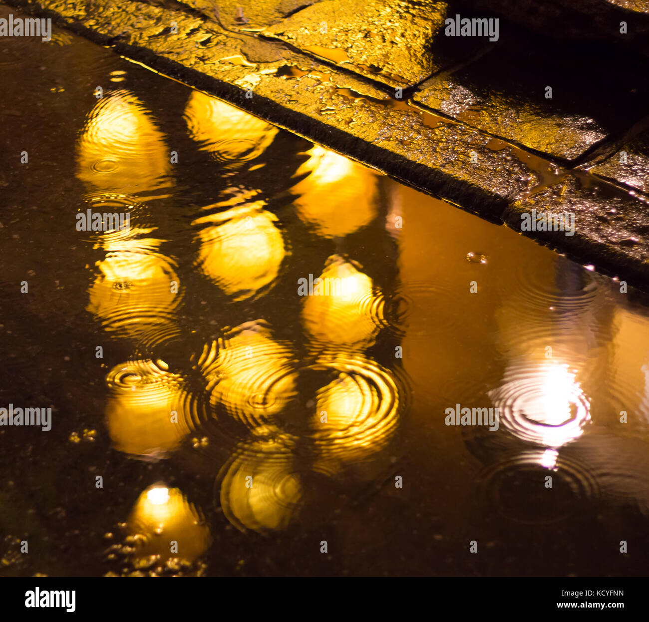 reflection of lights on wet rainy street - Stock Image