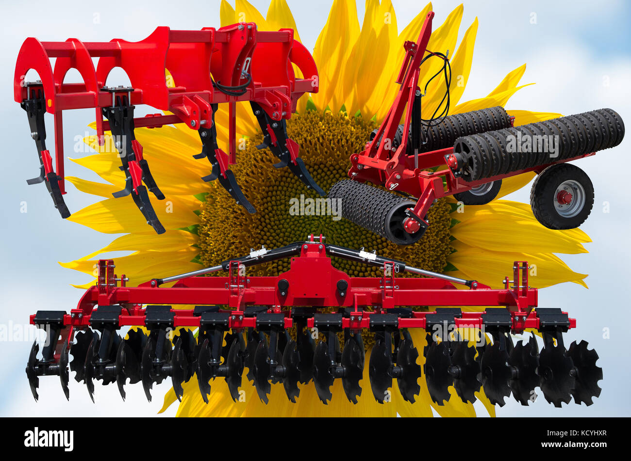 Farm equipment and implements - disc harrow, subsoiler, flat lifter and roller tractor trailer. - Stock Image
