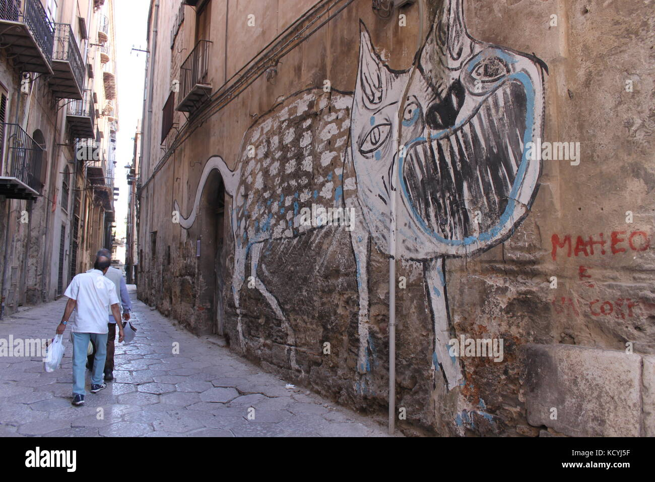 Scary wall art of a monster in an italian alley & Scary wall art of a monster in an italian alley Stock Photo ...