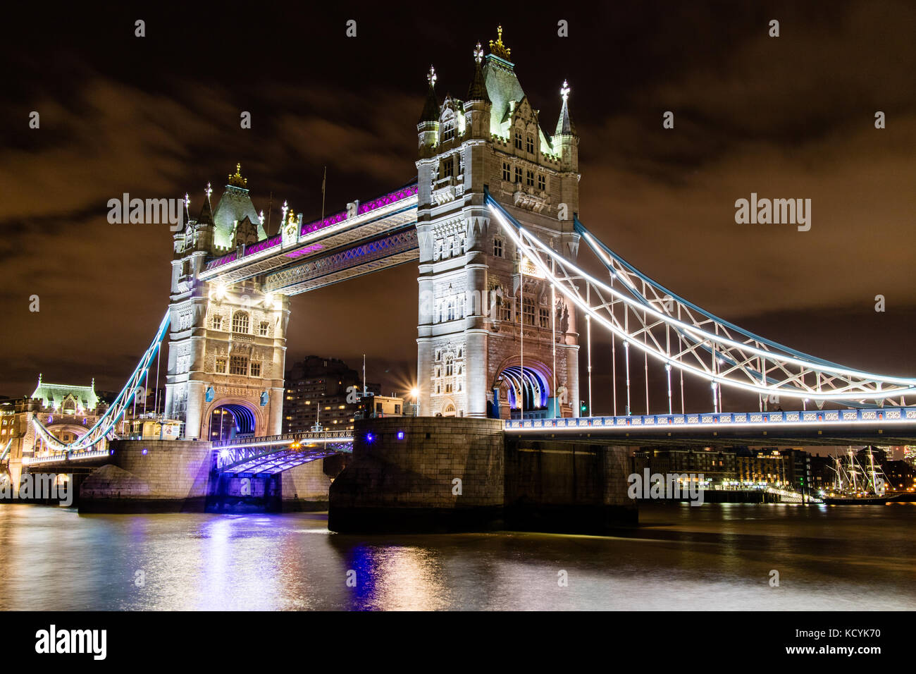 A long exposure of Tower Bridge at night. - Stock Image