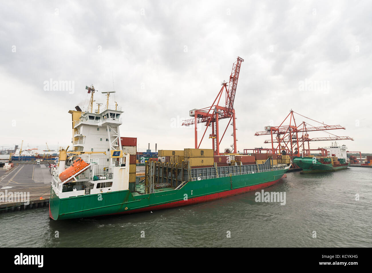Two large container ships being loaded with shipping containers at Dublin docks. - Stock Image