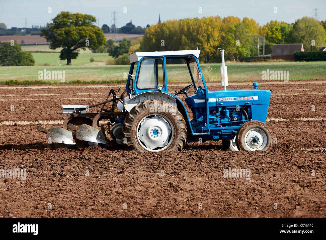 Ford 3000 Tractor Ploughing Stubble Field UK - Stock Image
