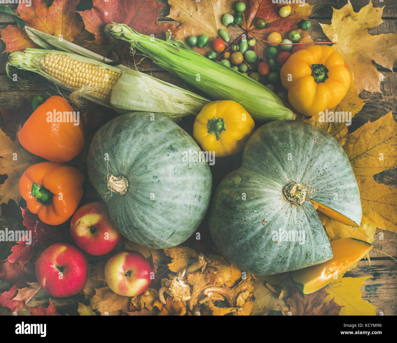Fall vegetables assortment over wooden table background - Stock Image