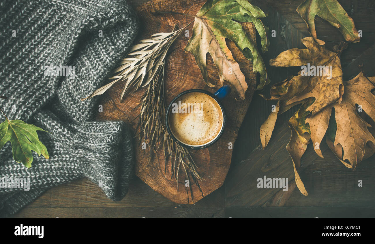 Autumn morning coffee concept with leaves and woolen sweater Stock Photo