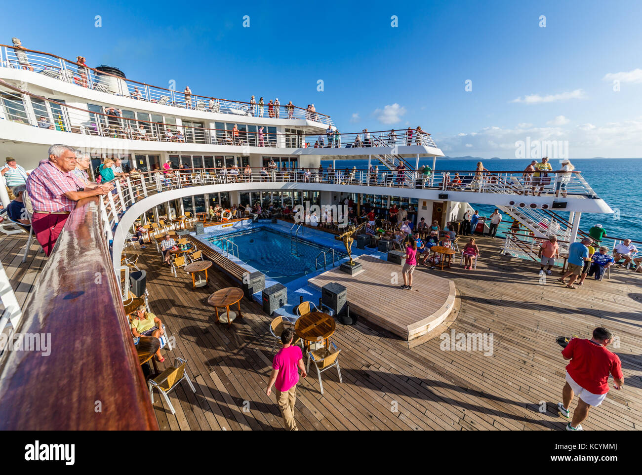 Deck party on the MV Marco Polo as it leaves Tortola - Stock Image