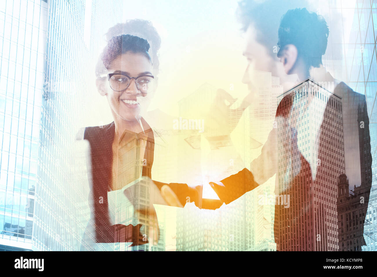 Handshake of two businessperson in office concept of partnership and teamwork.double exposure - Stock Image