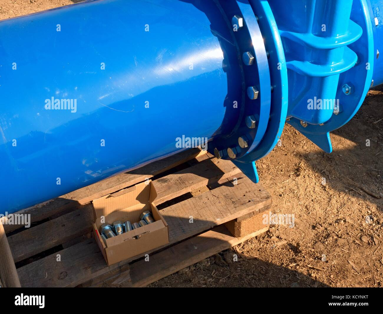 Detail of 500mm big new drink water joint unit with screws and nuts. Collar pipe fitting. Piping repair,  fasteners - Stock Image