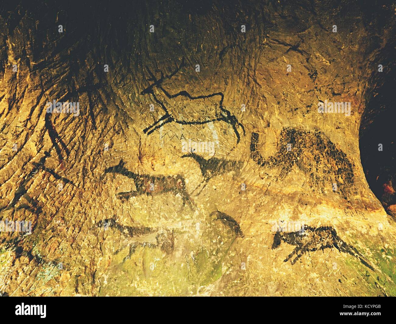 Paint of human hunting of deers, mammoth and reindeer. Historical black carbon abstract art in sandstone cave in - Stock Image