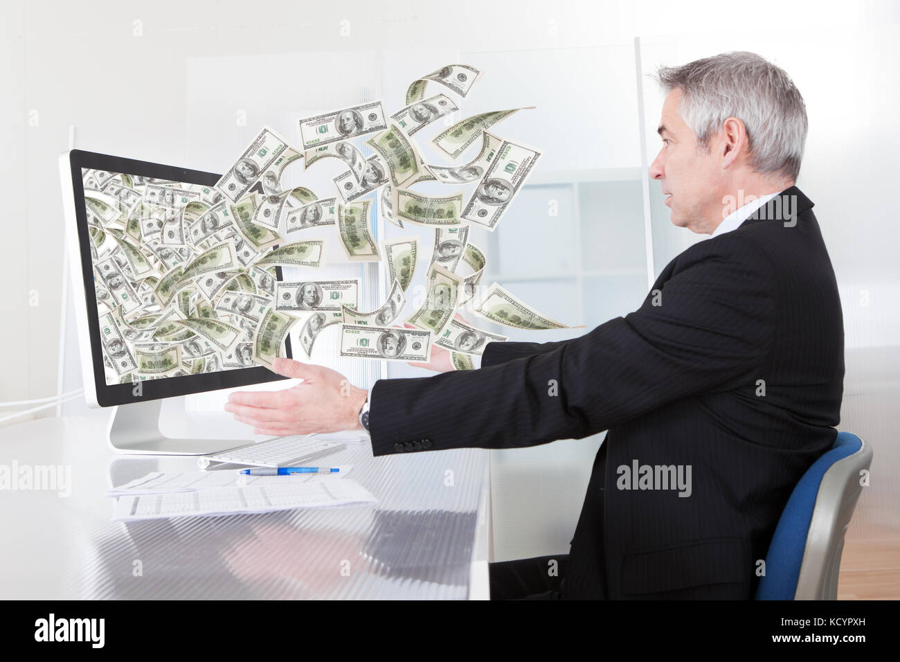 Businessman Earning Lots Of Cash In Internet - Stock Image