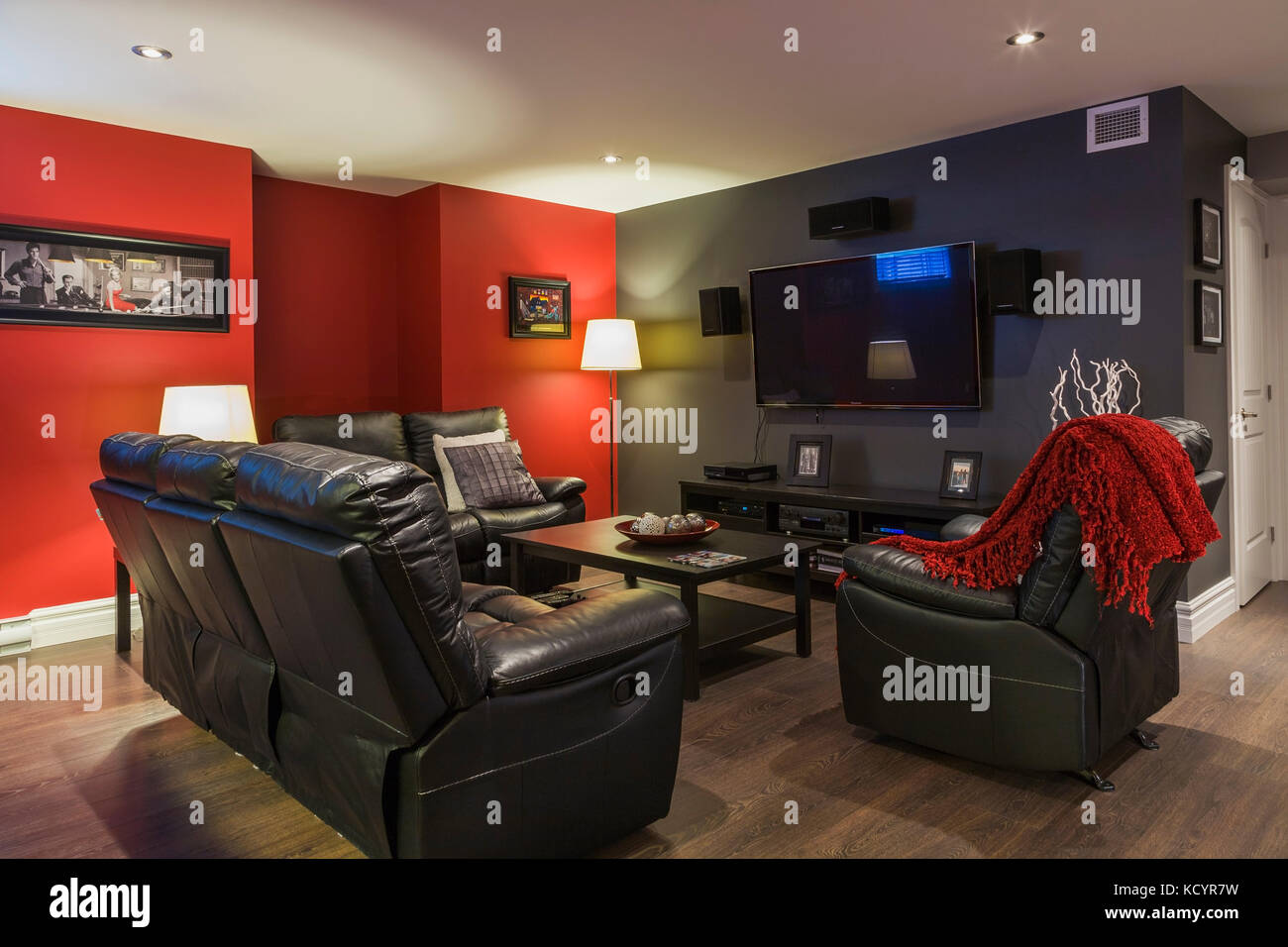 Picture of: Black Leather Sofas And Reclining Chair With Wooden Coffee Table In Stock Photo Alamy