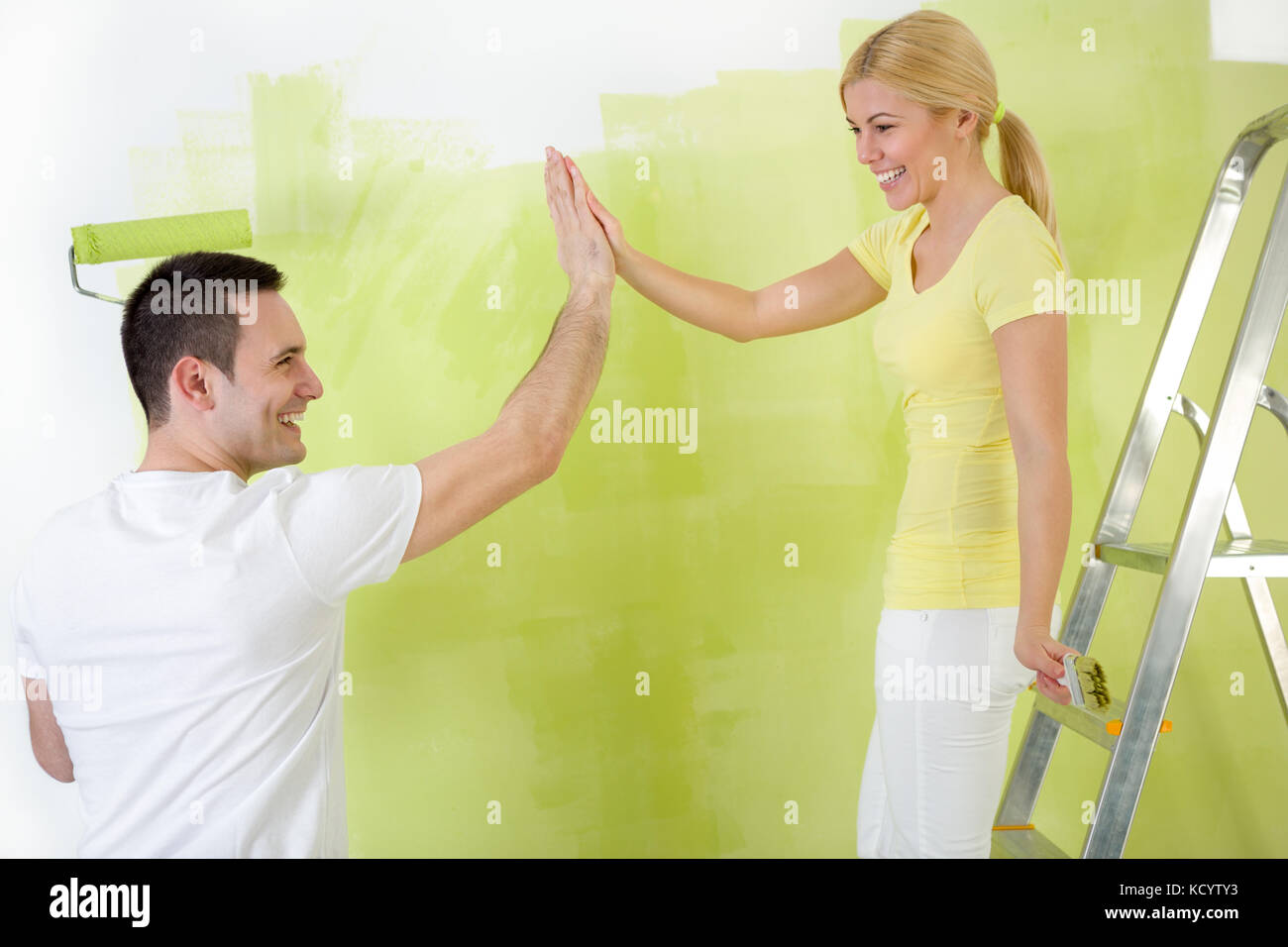 Happiness Young Couple Painting Together