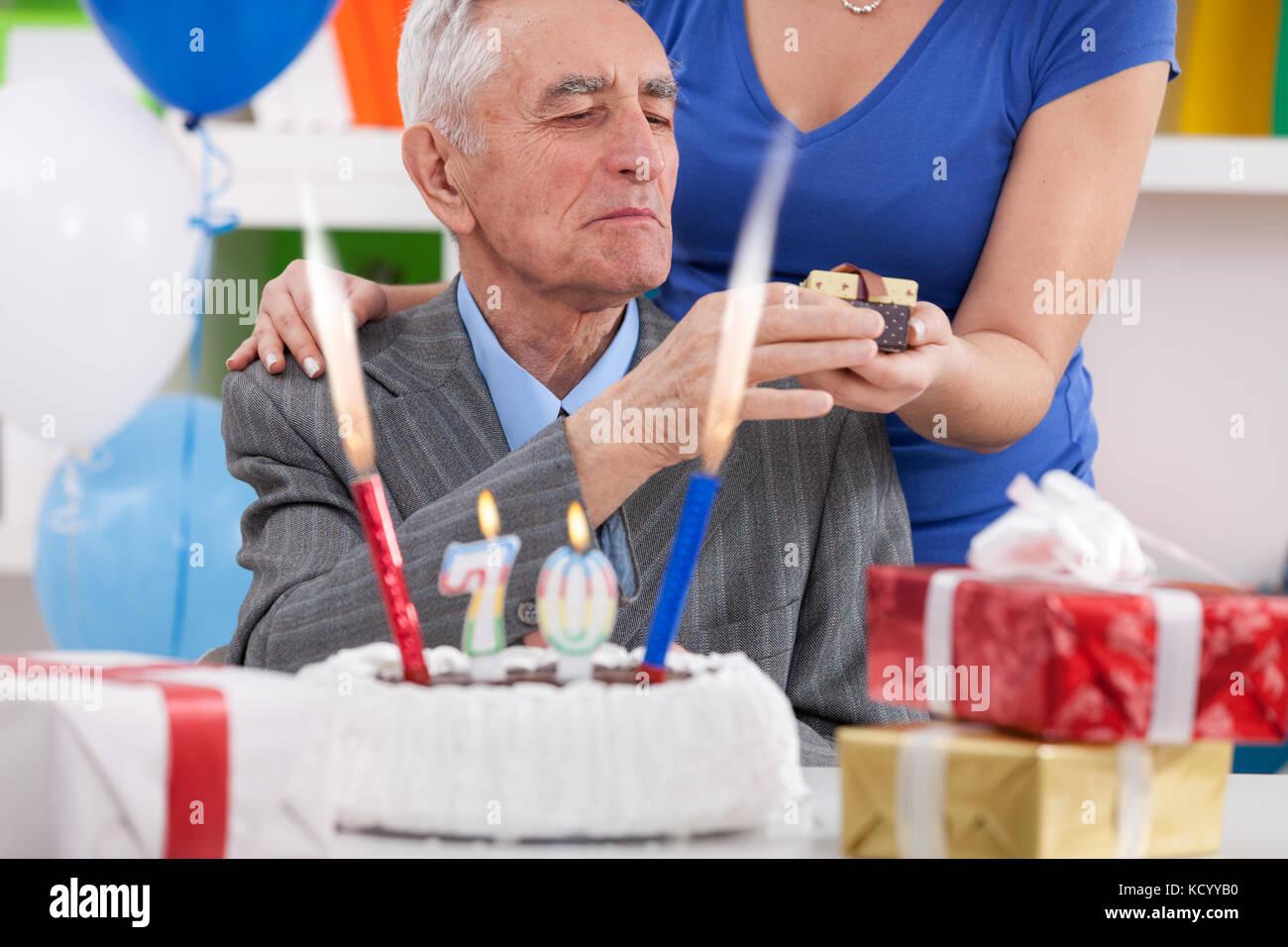 Senior Man Celebrating 70th Birthday And Receiving Gift