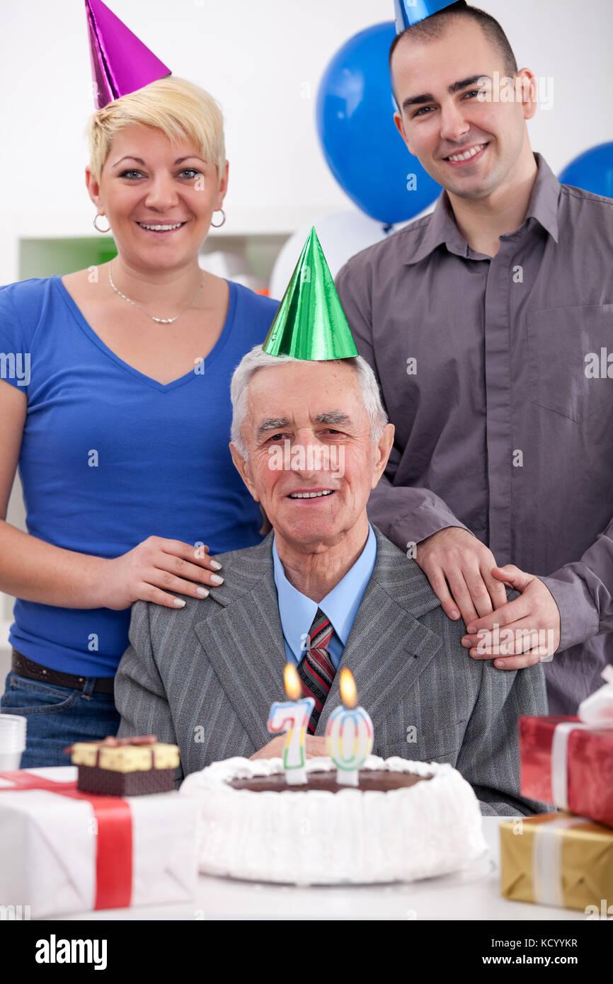 Senior Man Celebrating His 70th Birthday With Family