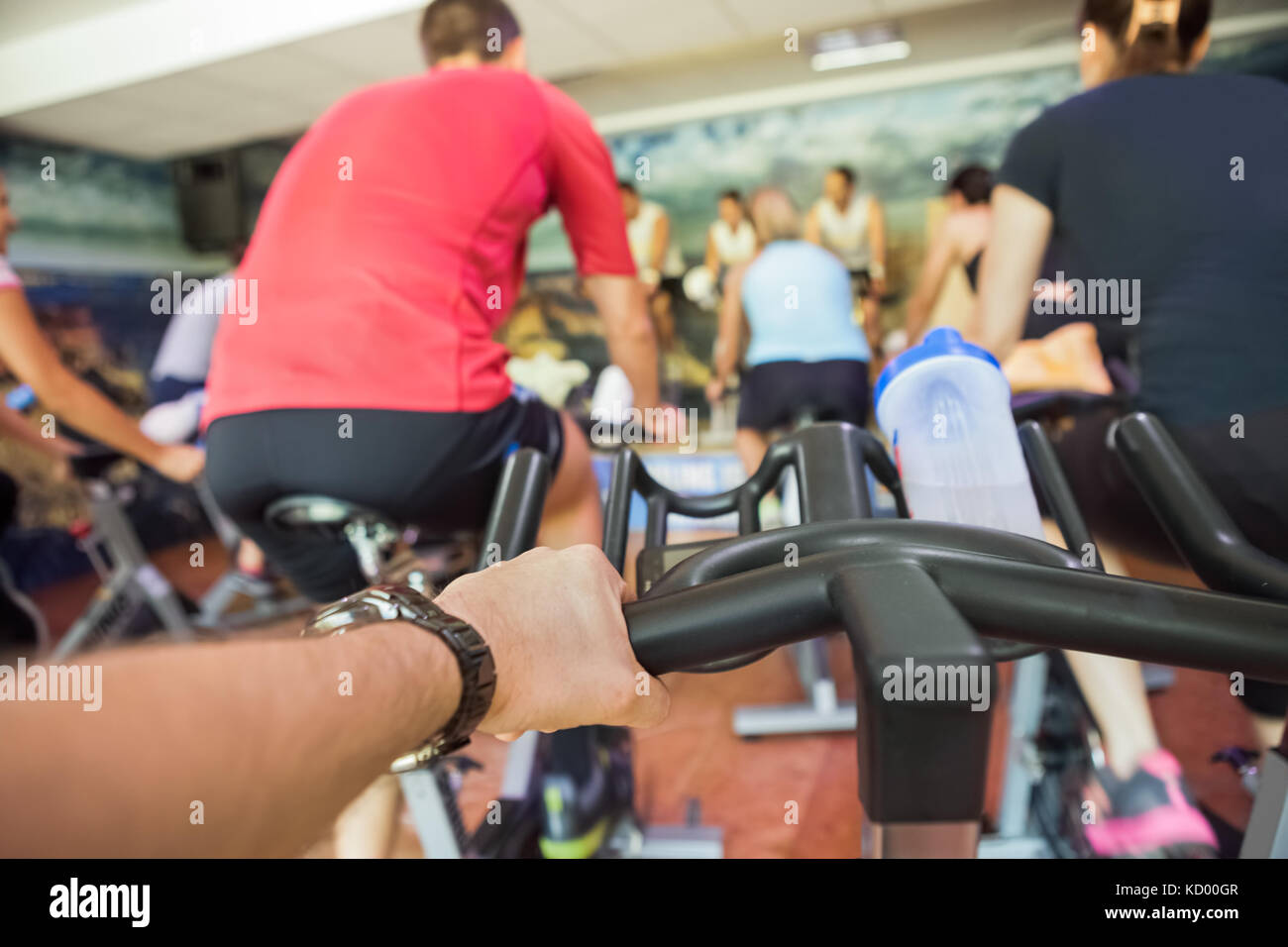 Spinning class sport people exercise at gym - Stock Image