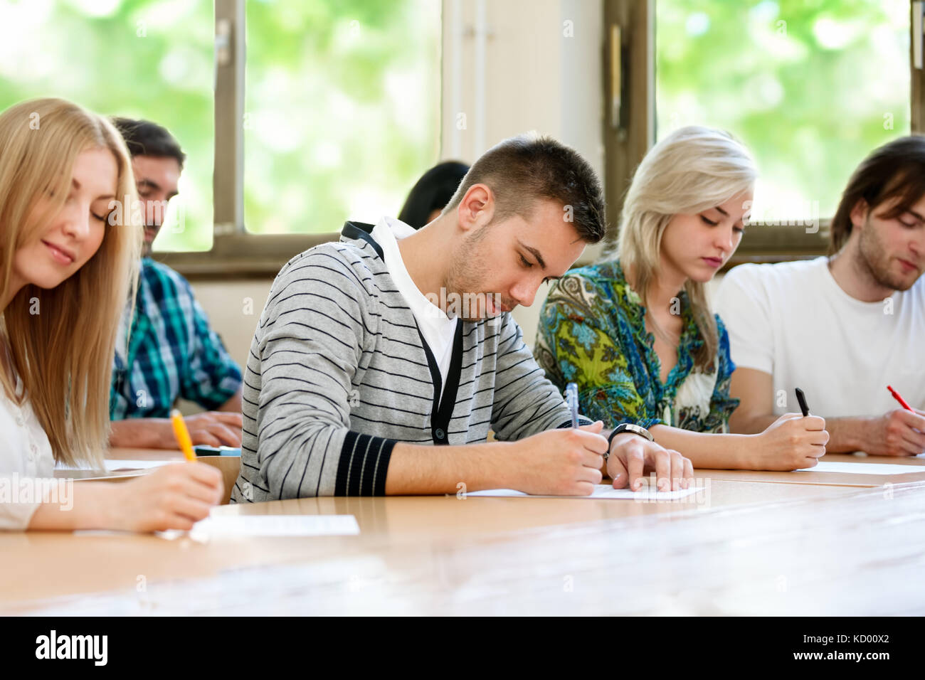 Group of students in class at the university - Stock Image