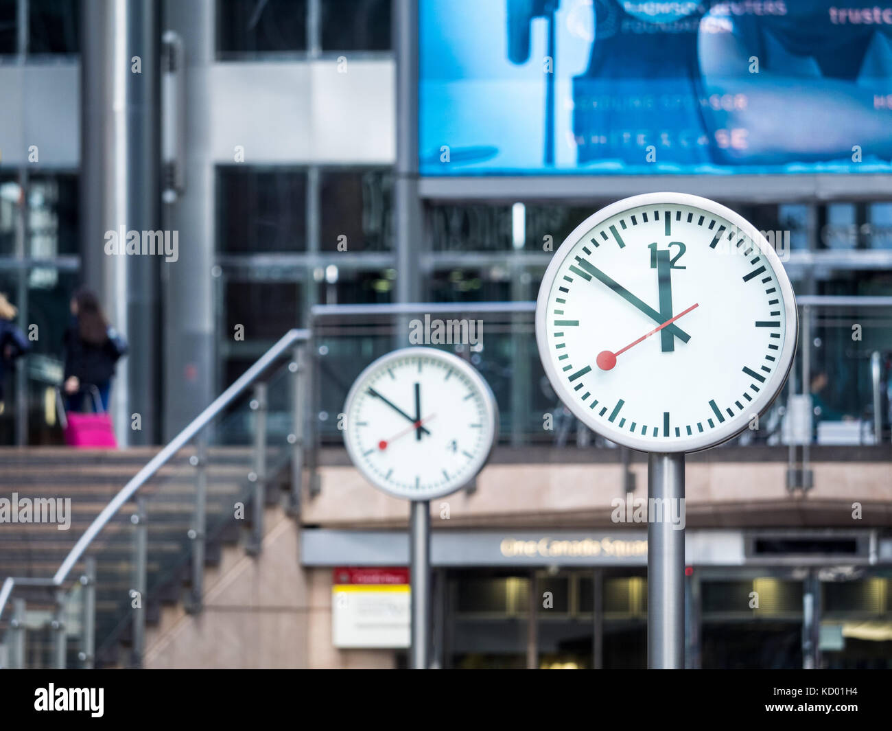 Clocks Canary Wharf Reuters Plaza - two of the Six Public Clocks artwork, by Konstantin Grcic, in Reuters Plaza - Stock Image