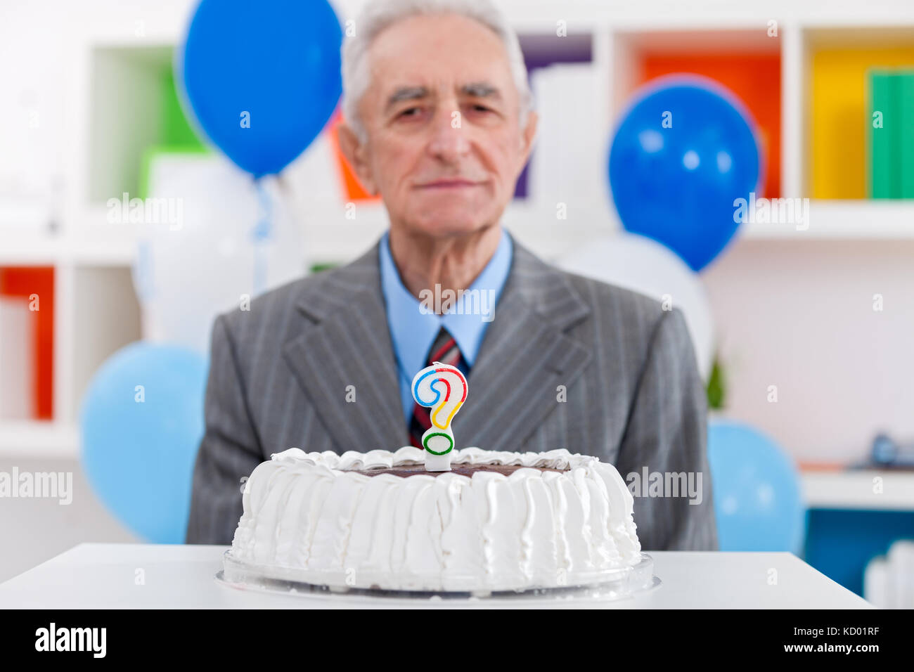 Senior Man With Birthday Cake A Question Mark Candle On It
