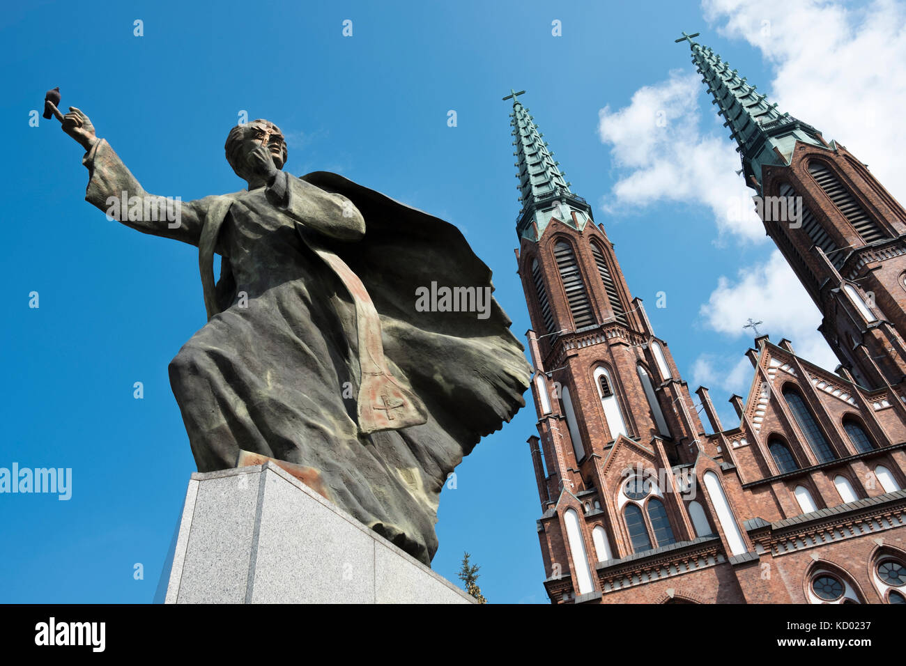 The statue of Father Ignacy Skorupka, outside St. Florian's Cathedral, in the Praga district of Warsaw, Poland. - Stock Image