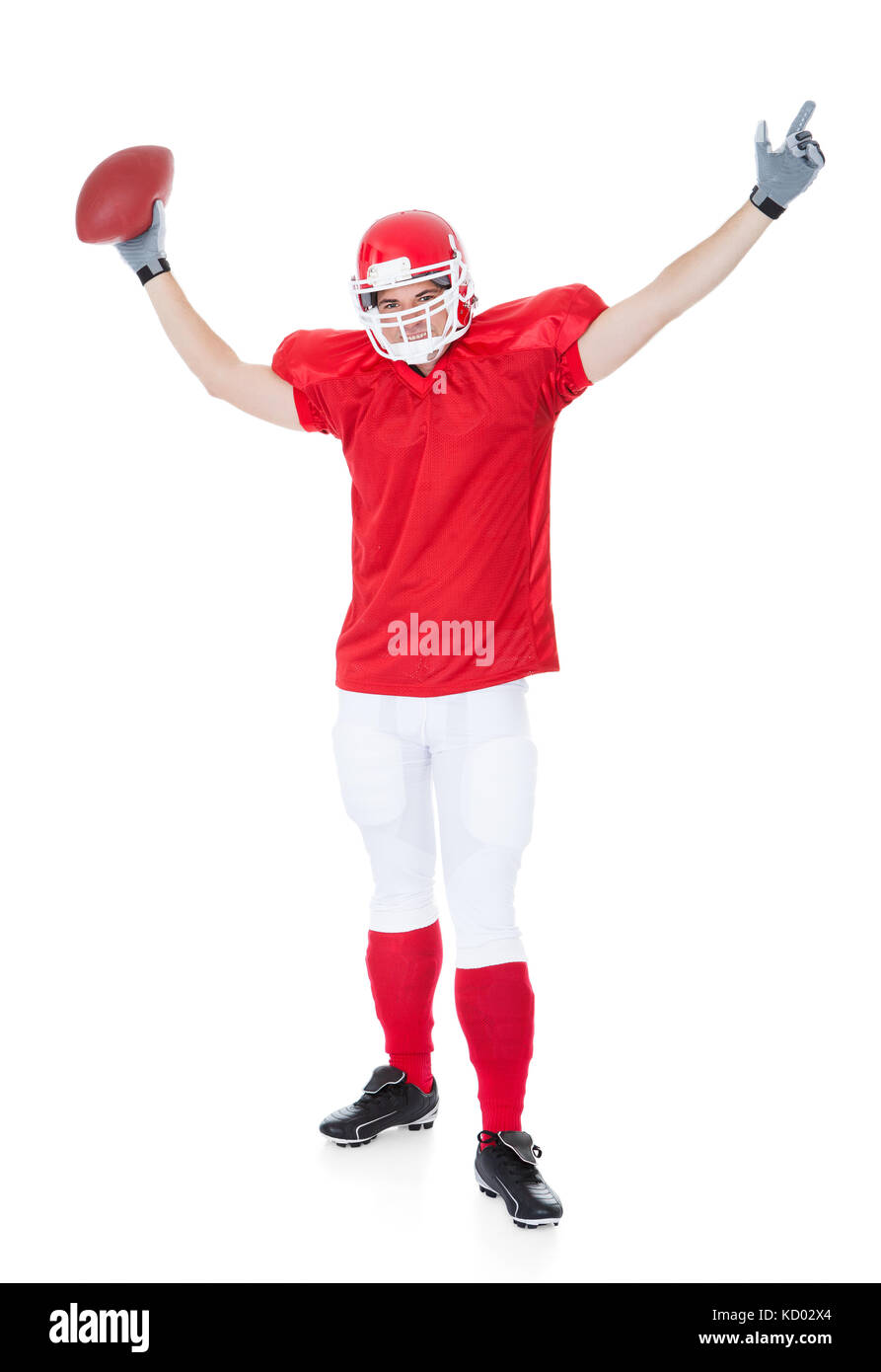 Portrait Of American Football Player On White Background - Stock Image