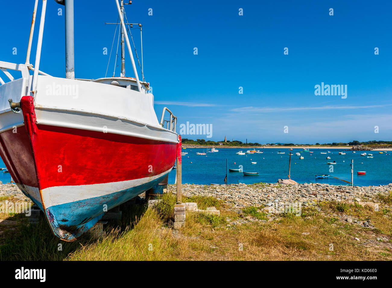 Fishing Boat on Shore in the Village of Vale, Guernsey, Channel Islands, UK on summer day - Stock Image