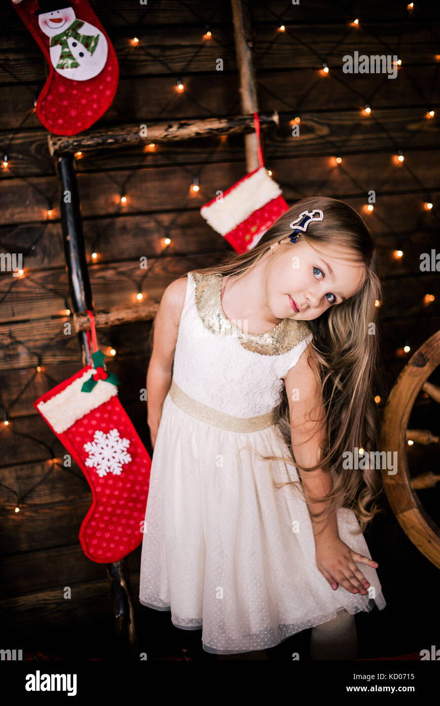 7b20c489d Baby girl 4-5 year old posing in room over christmas tree with Stock ...