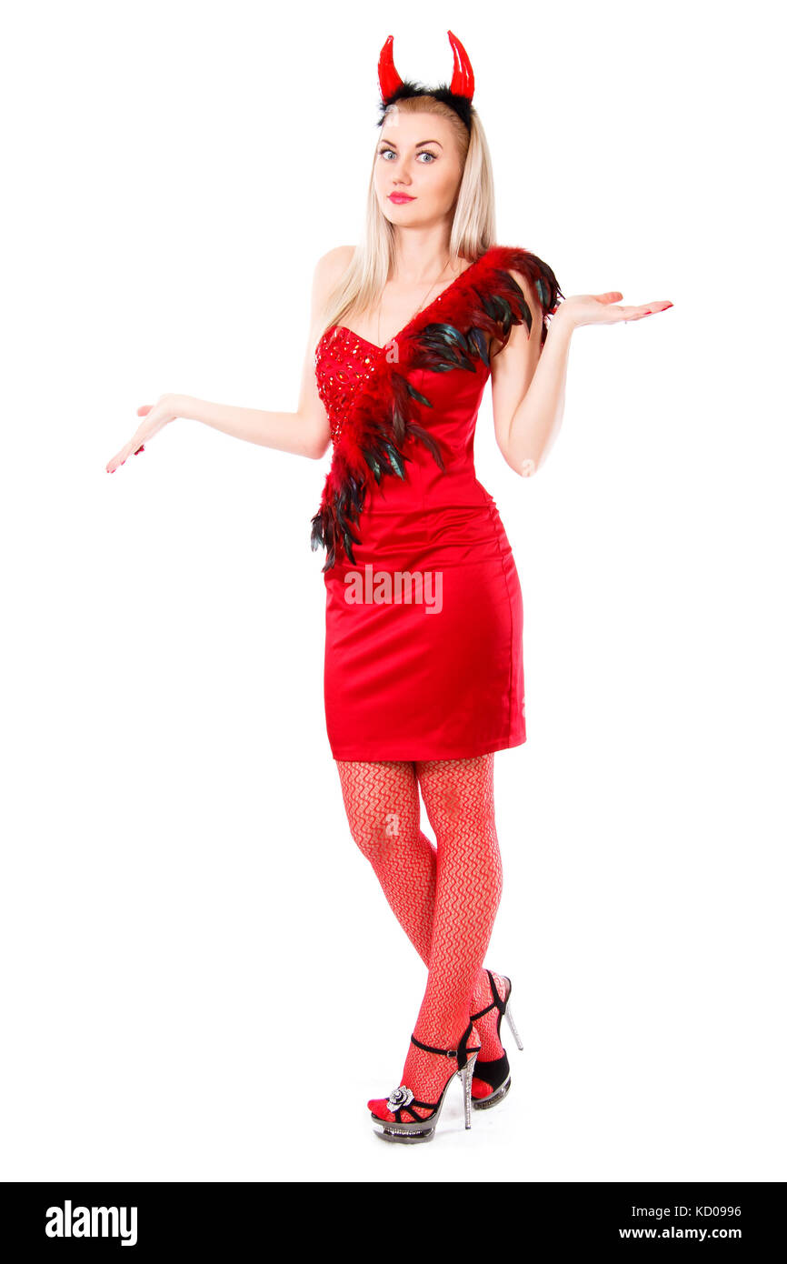 Misunderstanding young woman in a devil costume isolated over white background - Stock Image