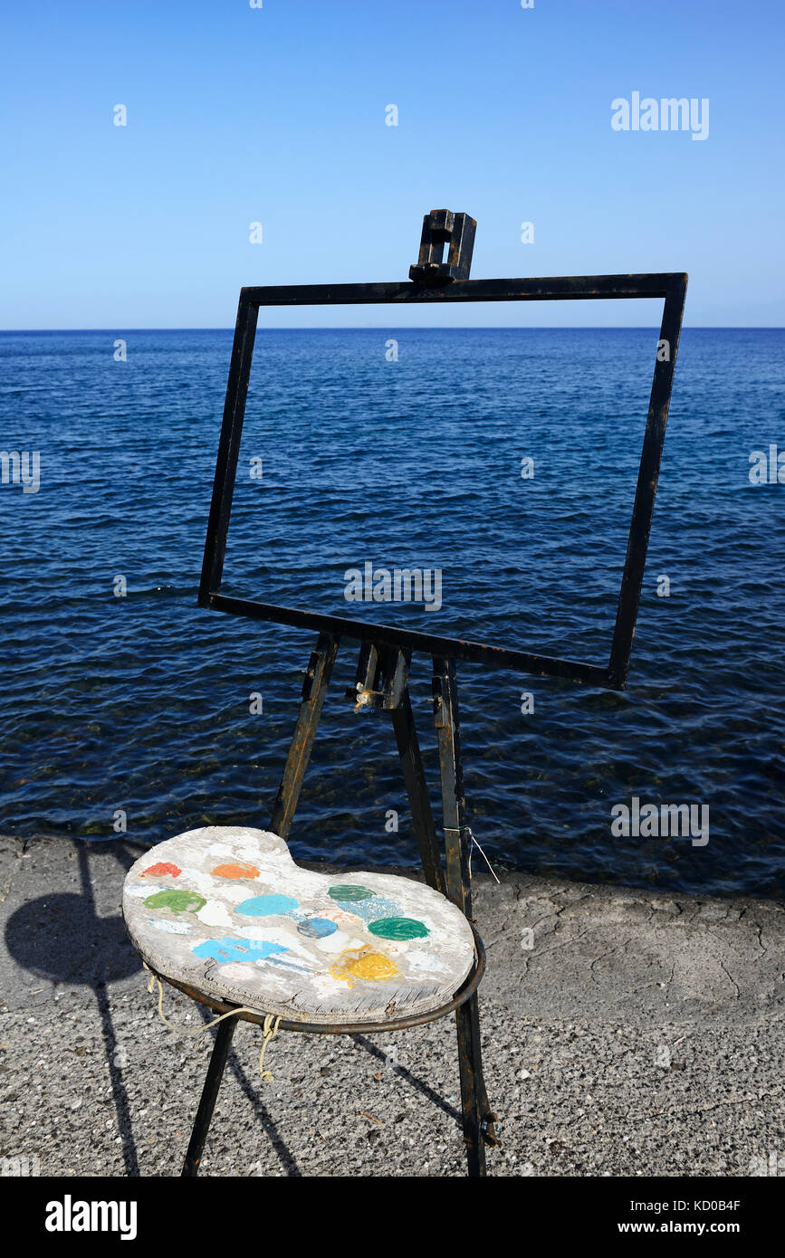 Easel and pallet in front of the sea, Vulcano Island, Lipari Islands, Italy - Stock Image