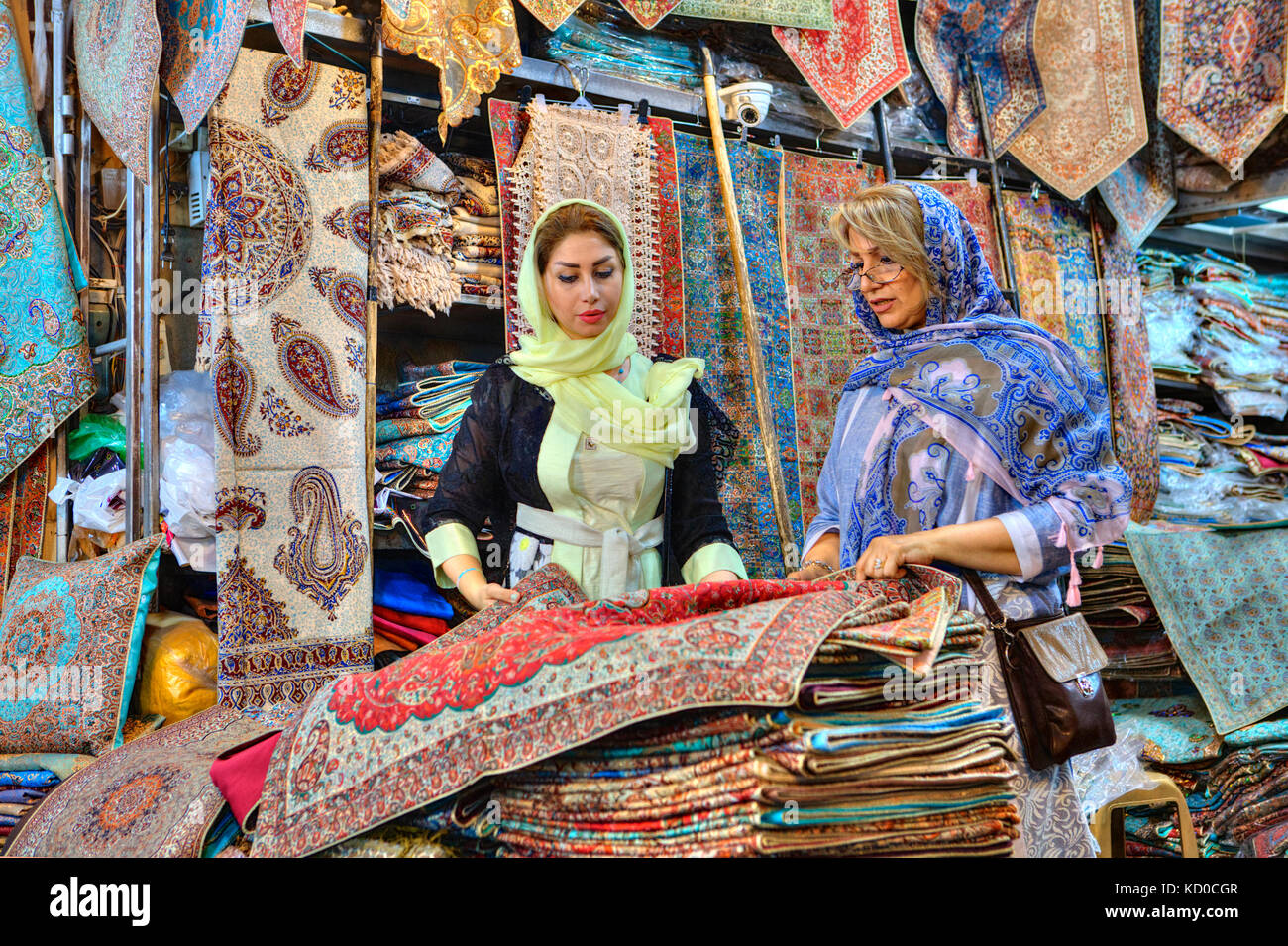 Fars Province, Shiraz, Iran - 19 april, 2017:  Two fashionable Iranian women, young and mature, dressed in bright - Stock Image