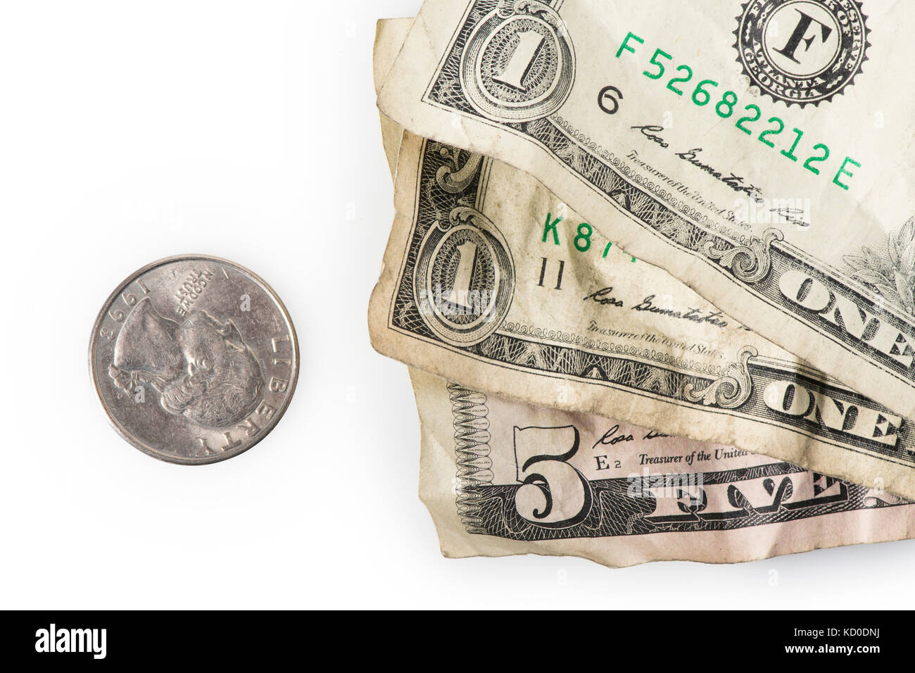 Wrinkled dollar bills and a quarter adding up to $7.25, the current (as of 2016) U.S. Federal Minimum wage. - Stock Image
