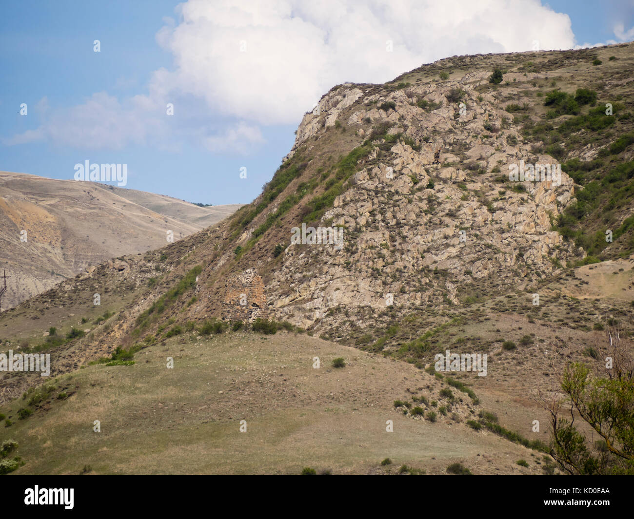 Springtime in the Lesser Caucasus area of Georgia near the Khertvisi Fortress, hilltop ruin and bare mountainsides - Stock Image